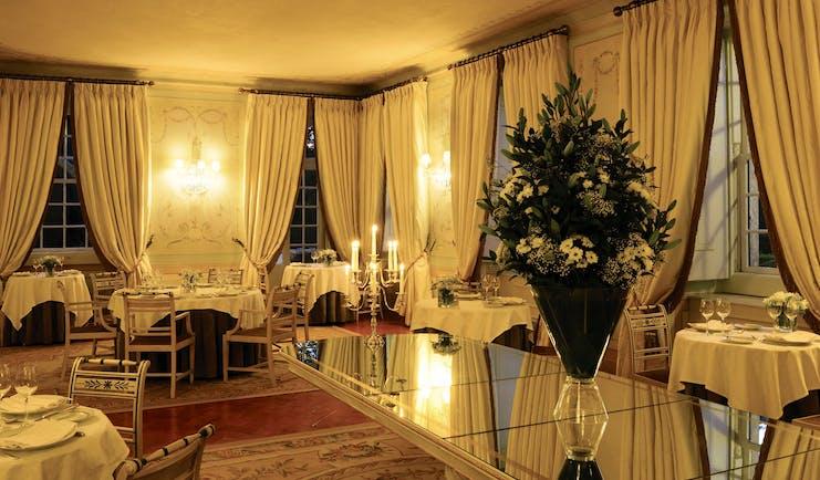 Tivoli Palacio de Seteais Portugal restaurant night large dining area with archway with draped curtains
