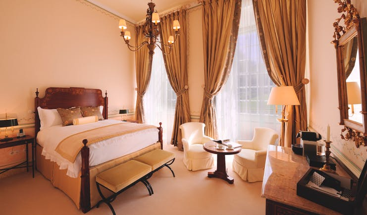 Tivoli Palacio de Seteais Portugal superior double bedroom with large windows and draped curtains and chairs and desk