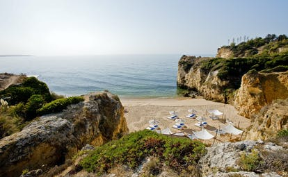 Vila Vita Parc Portugal beach cove with umbrellas and loungers