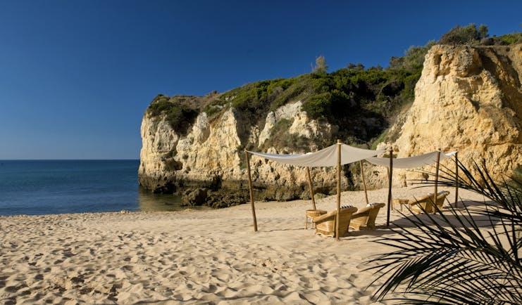 Vila Vita Parc Portugal beach cove with cabana and armchairs