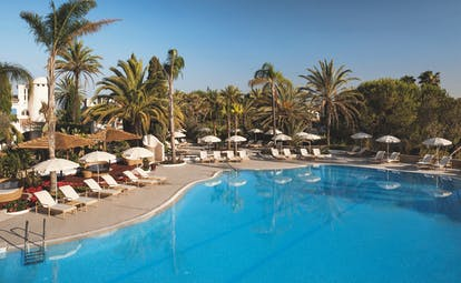 Vila Vita Parc Portugal outdoor pool with sun loungers and umbrellas