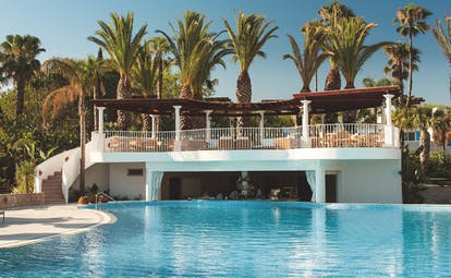 Vila Vita Parc Portugal pool bar outdoor swimming pool with swim up bar and elevated terrace