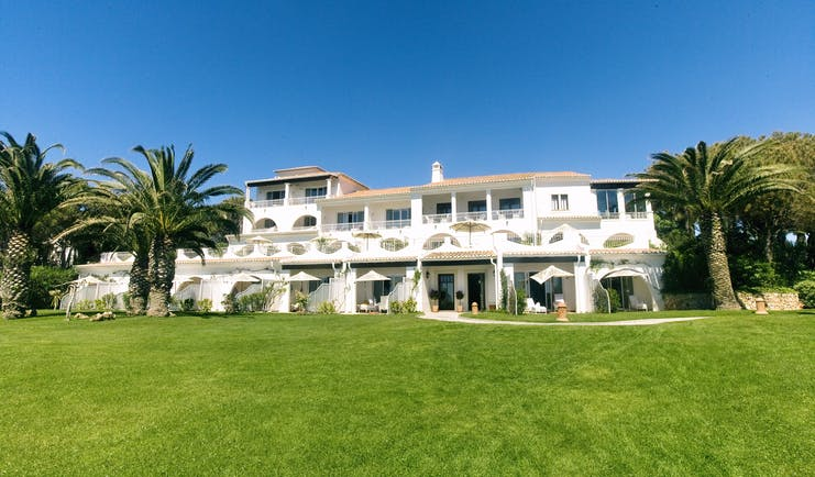 Vila Vita Parc Portugal residence gardens exterior view of white building with archways and palm trees