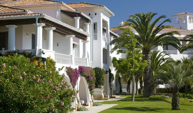 Vila Vita Parc Portugal exterior white villa with arches and balconies pink flowers and trees