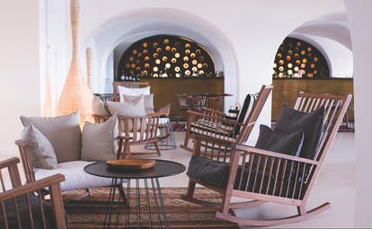 Lounge at the vilalara thalassa resort with wooden chairs and a grey and cream colour scheme