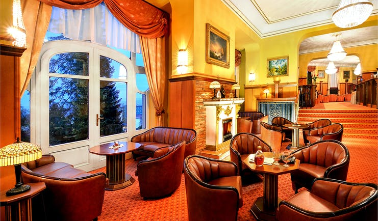 Grandhotel Stary Smokovec lobby, leather armchairs, open fire, grand traditonal decor