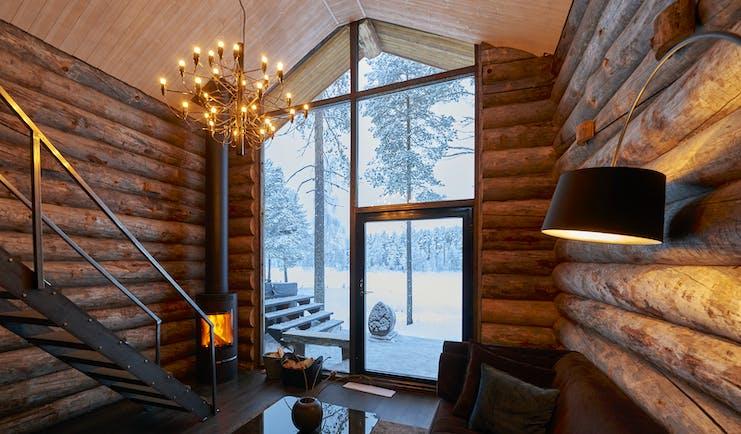 Arctic Retreat cabin interior, sofa, timber walls, modern light fitting