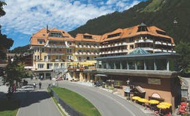 Hotel Silberhorn exterior, hotel building and entrance, authentic swiss architecture, mountain in background