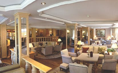 Romantik Hotel Schweizerhof lobby, sofas and armchairs, communal seating area, bright modern decor