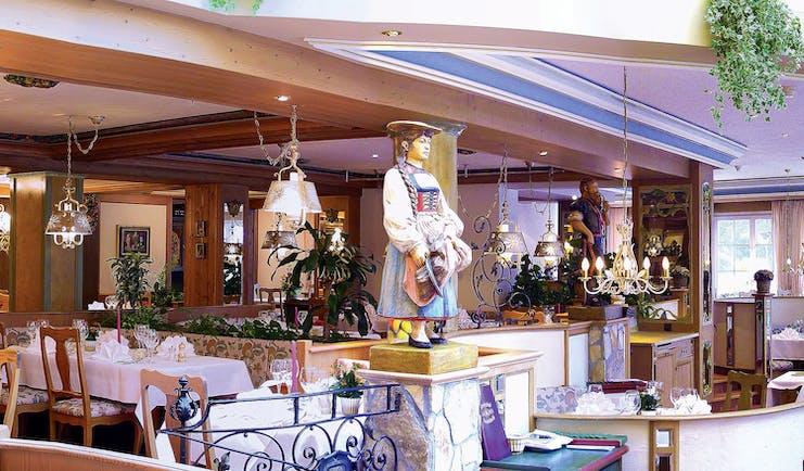 Romantik Hotel Schweizerhof restaurant entrance, traditional Swiss decor, statue of man and woman