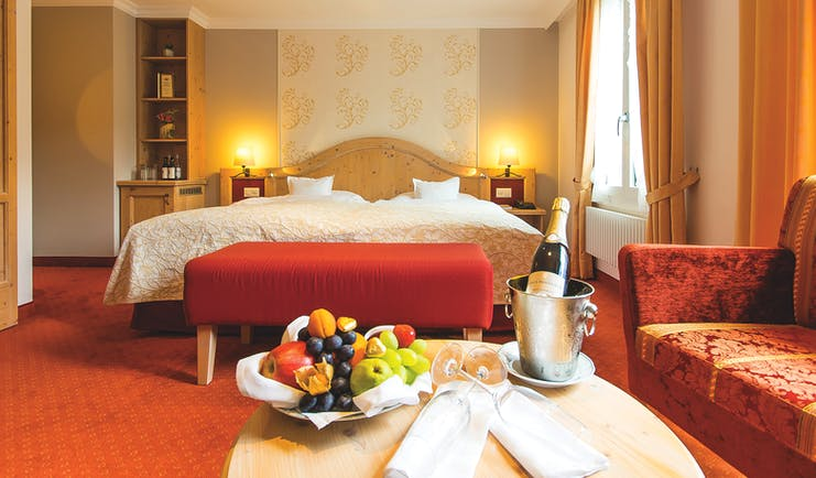Romantik Hotel Schweizehof superior room, twin bed, sofa, colourful traditional decor