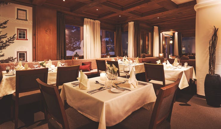 Arabella Hotel restaurant, dining tables and chairs, cosy modern decor