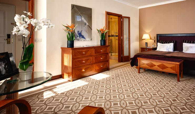 Kempinski Grand Hotel des Bains Grisons and the Engadine superior double bedroom ottoman armchairs and chest of drawers