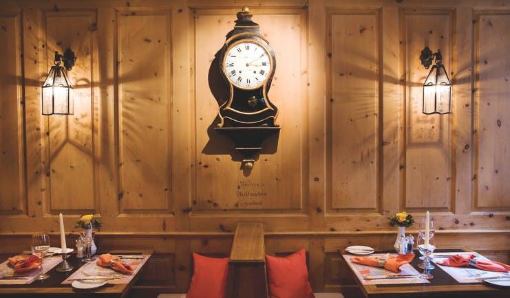 Romantik Hotel Stern bar, traditional Swiss decor, wood panells, wooden benches, grandfather clock on wall