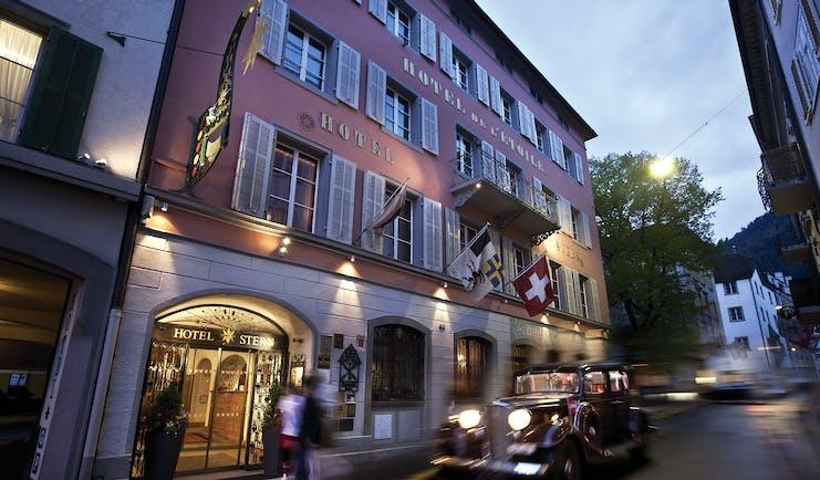 Romantik Hotel Stern exterior, pink grand building on corner of street