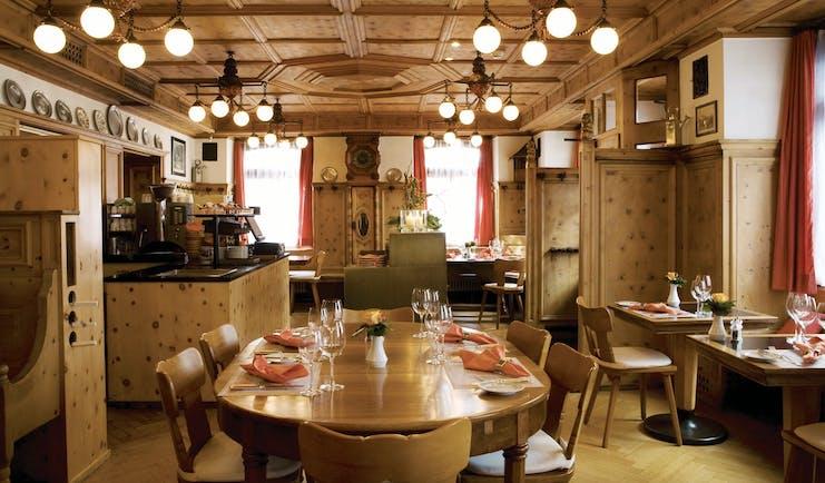 Romantik Hotel Stern restaurant, traditional Swiss decor, wooden panels, wooden table