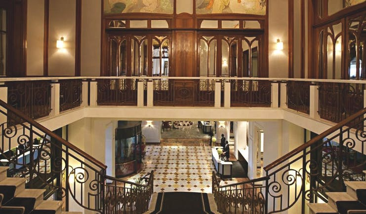 Fairmont le Montreux Palace Lake Geneva lobby leading to stair case and ornate wood doors