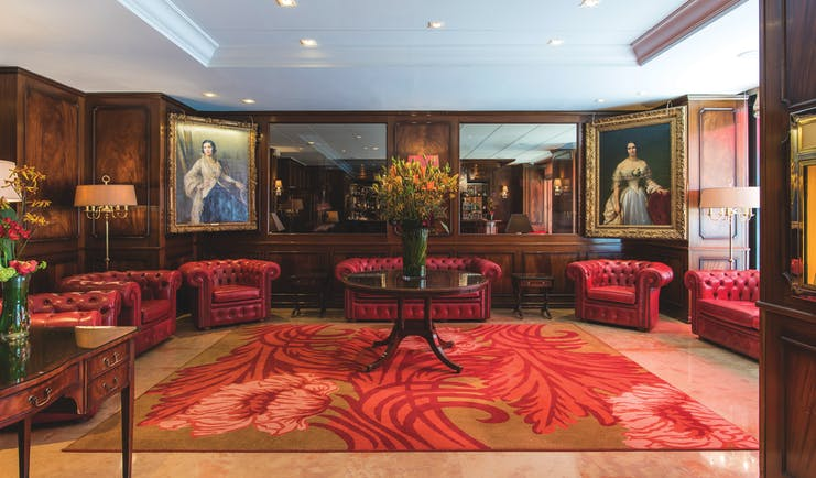 Hotel Bristol lobby, leather sofas and chairs, grand decor, wood panelling and historic paintings