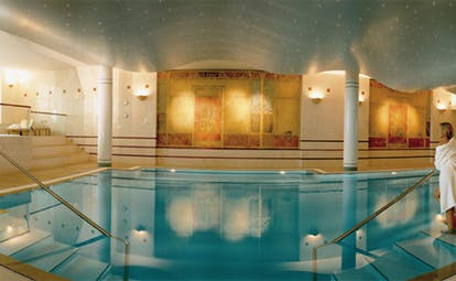 Lausanne Palace Switzerland indoor pool with columns and loungers