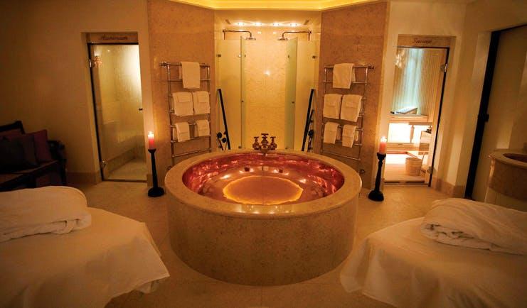 Lausanne Palace Switzerland spa suite beds freestanding copper bath showers