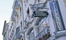 Tiffany Hotel bulding details, hotel sign, traditional architecture, white walls, metal railing balconies