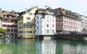 Exterior of Hotel Wilden Mann shown on the lake with multi-coloured buildings