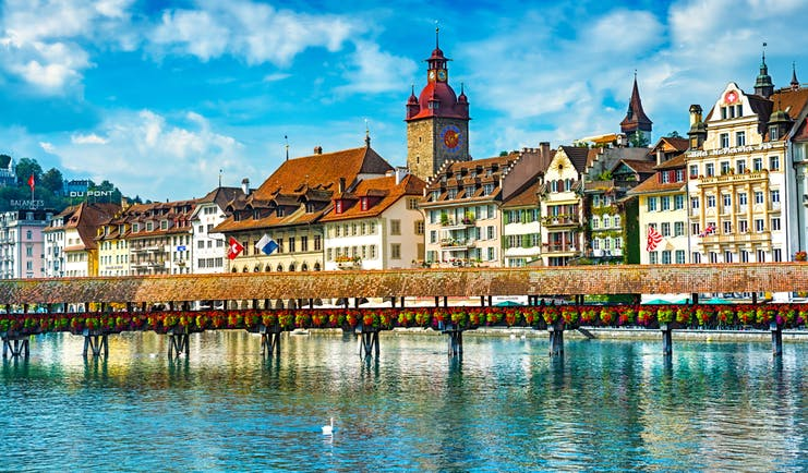 Lucerne town on the shore of Lake Lucerne, grand fronted houses, clock tower, traditional architecture