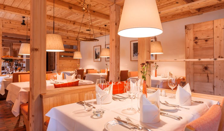 Gstaaderhof pale wooden walls and ceiling in restaurant with white table cloths