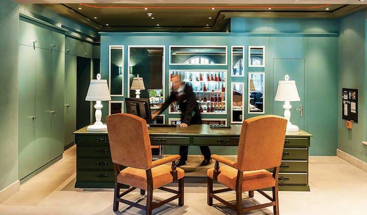 Le Grand Bellevue reception desk, velvet chairs, grand colourful decor, concierge