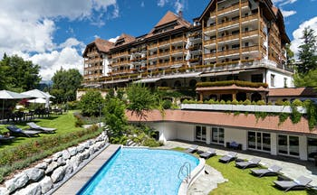 Chalet style exterior of Park Gstaad with rooms with balconies, garden and swimming pool