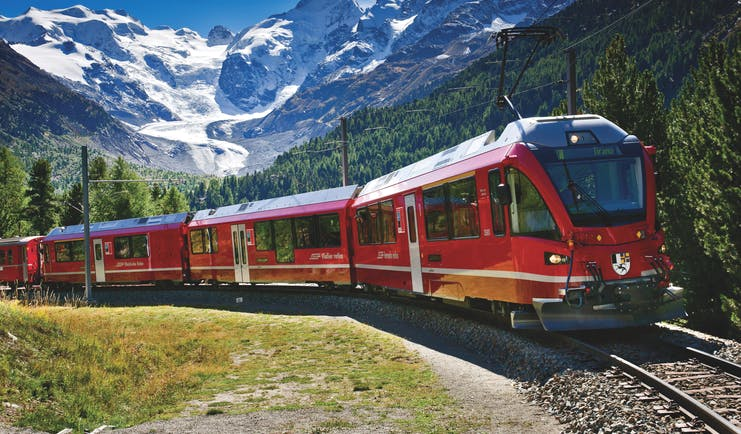 Red Bernina Express train on the famous Montebello curve of the track