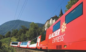 Glacier Express red train in summer mountain landscape