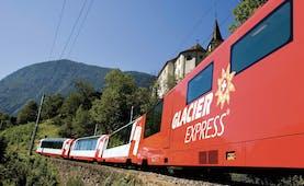 Glacier Express red train in summer mountain landscape