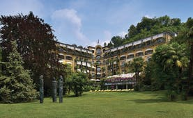 Grand Hotel Castagnola exterior, hotel building, swiss style architecture, lawn, trees