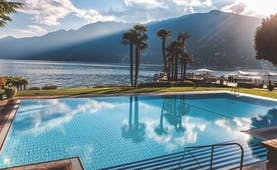 Hotel Eden Roc outdoor pool, overlooking lake, mountains in background