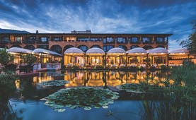 Hotel Giardino Ascona exterior, hotel building, ponds, restaurant and terrace lit up