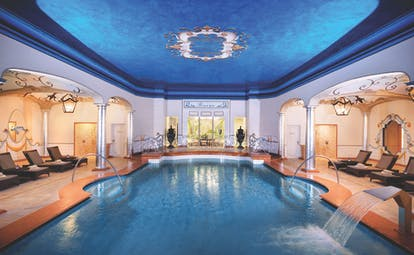 Hotel Giardino Ascona indoor pool, sun loungers, water feature, grand architectural details