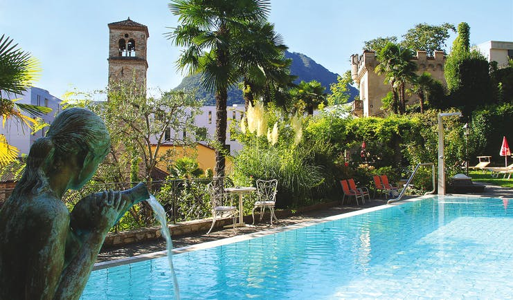 Hotel International au Lac Ticino outdoor pool with statue of a woman