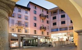 Hotel Lugano Dante entrance, hotel building seen from corner of square, hotel entrance