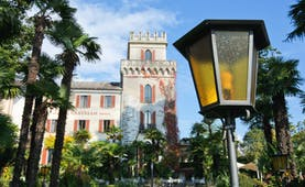 Romantik Hotel Castello Seeschloss Ticino exterior, hotel building in traditional architecture, streetlamps, trees
