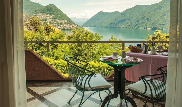 Villa Principe Leopoldo balcony with table and chairs overlooking lake and mountains