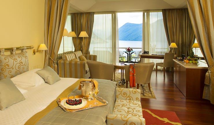 Villa Principe Leopoldo bedroom with lake view, and red carpet