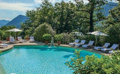 Villa Principe Leopoldo pool with mountains in background