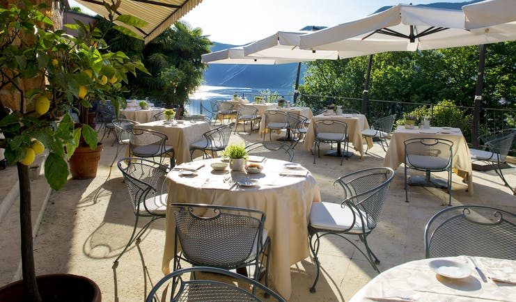 Villa Principe Leopoldo outdoor seating on terrace with sunshades and lake views