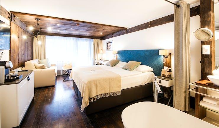 Hotel Alpenhof Zermatt large white and brown room with open bathroom