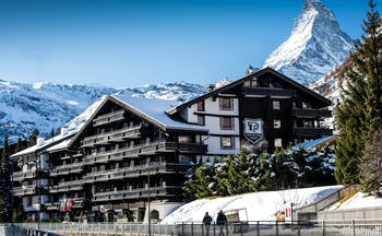 Hotel Alpenhof Zermatt outside of wooden chalet hotel in the snow with Matterhorn mountain behind
