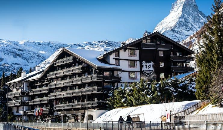 Hotel Alpenhof Zermatt outside of wooden chalet hotel in the snow with Matterhorn mountain behind