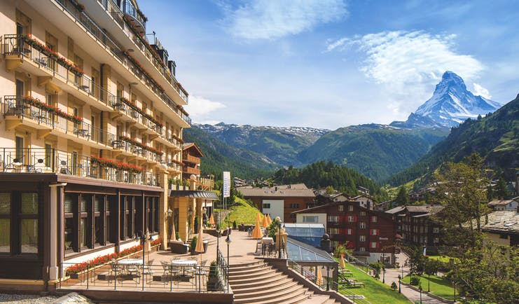 Park Hotel Beau Site exterior, hotel building, swiss style architecture, gardens, mountains in background