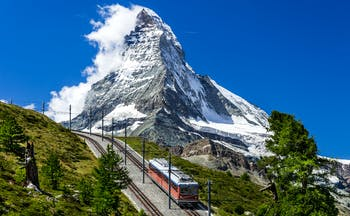 Gornergratbahn in Valais, mountain rack railway, snowcapped Gornergrat in background
