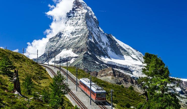 Gornergratbahn in Valais, mountain rack railway, snowcapped Gornergrat in background